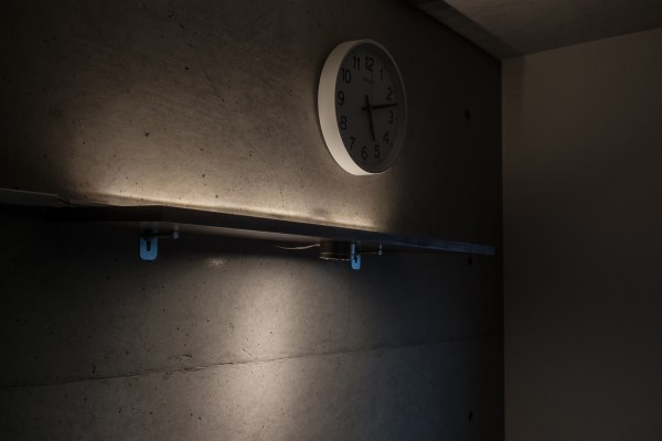 How to attach shelf board and ikea lighting to concrete wall